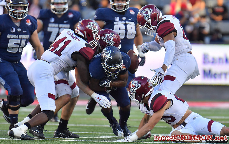 December 29, 2017; Tucson, AZ, USA;  New Mexico State Aggies linebacker Leon McQuaker (41) tackles Utah State Aggies wide receiver Aaren Vaughns (83) during the NOVA Home Loans Arizona Bowl at Arizona Stadium in Tucson, Ariz.  Photo by Sam Wasson/bleedCrimson.net