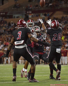 LAS CRUCES, NEW MEXICO - OCTOBER 05, 2019:  Linebacker Devin Richardson #3, defensive back Rodney McGraw II #21 and linebacker Jonathan Hood #20 of the New Mexico State Aggies wait to down a punt during their game against the Liberty Flames at Aggie Memorial Stadium on October 05, 2019 in Las Cruces, New Mexico.  (Photo by Sam Wasson)