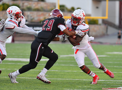 LAS CRUCES, NEW MEXICO - OCTOBER 05, 2019:  Defensive back Jared Phipps #29 of the New Mexico State Aggies tackles wide receiver DJ Stubbs #5 of the Liberty Flames during their game at Aggie Memorial Stadium on October 05, 2019 in Las Cruces, New Mexico.  (Photo by Sam Wasson)