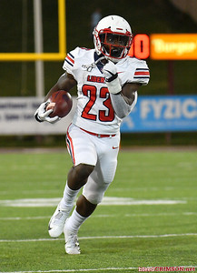 LAS CRUCES, NEW MEXICO - OCTOBER 05, 2019:  Running back Frankie Hickson #23 of the Liberty Flames runs for a gain against the New Mexico State Aggies during their game at Aggie Memorial Stadium on October 05, 2019 in Las Cruces, New Mexico.  (Photo by Sam Wasson)