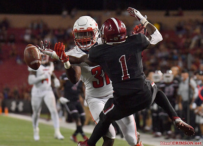 LAS CRUCES, NEW MEXICO - OCTOBER 05, 2019:  Running back Jason Huntley #1 of the New Mexico State Aggies tries to catch a pass against safety Elijah Benton #31 of the Liberty Flames during their game at Aggie Memorial Stadium on October 05, 2019 in Las Cruces, New Mexico.The Flames defeated the Aggies 20-13.  (Photo by Sam Wasson)