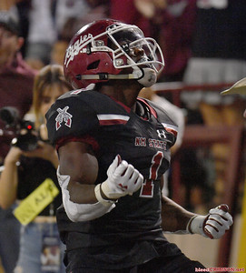 LAS CRUCES, NEW MEXICO - OCTOBER 05, 2019:  Running back Jason Huntley #1 of the New Mexico State Aggies celebrates after scoring a touchdown against the Liberty Flames during their game at Aggie Memorial Stadium on October 05, 2019 in Las Cruces, New Mexico.  (Photo by Sam Wasson)