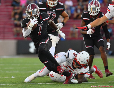 LAS CRUCES, NEW MEXICO - OCTOBER 05, 2019:  Running back Jason Huntley #1 of the New Mexico State Aggies runs against linebacker Solomon Ajayi #14 of the Liberty Flames during their game at Aggie Memorial Stadium on October 05, 2019 in Las Cruces, New Mexico.The Flames defeated the Aggies 20-13.  (Photo by Sam Wasson)