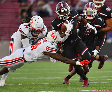 LAS CRUCES, NEW MEXICO - OCTOBER 05, 2019:  Running back Jason Huntley #1 of the New Mexico State Aggies runs against safety Elijah Benton #31 of the Liberty Flames during their game at Aggie Memorial Stadium on October 05, 2019 in Las Cruces, New Mexico.The Flames defeated the Aggies 20-13.  (Photo by Sam Wasson)