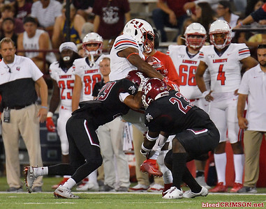 LAS CRUCES, NEW MEXICO - OCTOBER 05, 2019:  Defensive back Jared Phipps #29 and linebacker Rashie Hodge Jr. #23 of the New Mexico State Aggies tackle wide receiver Antonio Gandy-Golden #11 of the Liberty Flames during their game at Aggie Memorial Stadium on October 05, 2019 in Las Cruces, New Mexico.  (Photo by Sam Wasson)