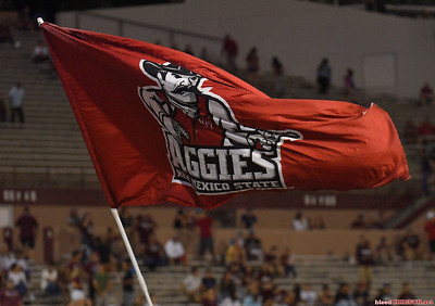 LAS CRUCES, NEW MEXICO - OCTOBER 05, 2019:  A New Mexico State Aggies flag is waved after the team scored a touchdown against the Liberty Flames during their game at Aggie Memorial Stadium on October 05, 2019 in Las Cruces, New Mexico.  (Photo by Sam Wasson)