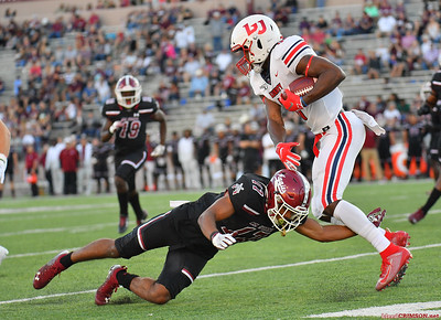 LAS CRUCES, NEW MEXICO - OCTOBER 05, 2019:  Wide receiver Antonio Gandy-Golden #11 of the Liberty Flames gets through a tackle from defensive back Jason Simmons Jr. #17 of the New Mexico State Aggies during their game at Aggie Memorial Stadium on October 05, 2019 in Las Cruces, New Mexico.  (Photo by Sam Wasson)
