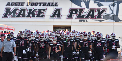 LAS CRUCES, NEW MEXICO - OCTOBER 05, 2019:  The New Mexico State Aggies line up to head onto the field before their game against the Liberty Flames at Aggie Memorial Stadium on October 05, 2019 in Las Cruces, New Mexico.The Flames defeated the Aggies 20-13.  (Photo by Sam Wasson)