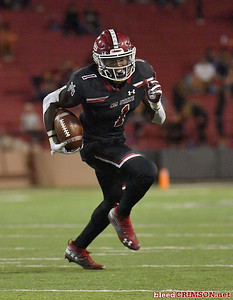 LAS CRUCES, NEW MEXICO - OCTOBER 05, 2019:  Running back Jason Huntley #1 of the New Mexico State Aggies runs for a gain against the Liberty Flames during their game at Aggie Memorial Stadium on October 05, 2019 in Las Cruces, New Mexico.  (Photo by Sam Wasson)