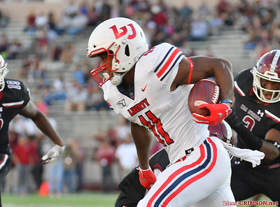 LAS CRUCES, NEW MEXICO - OCTOBER 05, 2019:  Wide receiver Antonio Gandy-Golden #11 of the Liberty Flames runs after catching a pass against the New Mexico State Aggies during their game at Aggie Memorial Stadium on October 05, 2019 in Las Cruces, New Mexico.  (Photo by Sam Wasson)