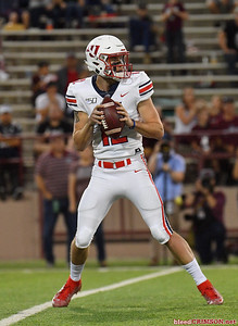 LAS CRUCES, NEW MEXICO - OCTOBER 05, 2019:  Quarterback Stephen Calvert #12 of the Liberty Flames looks to pass against the New Mexico State Aggies during their game at Aggie Memorial Stadium on October 05, 2019 in Las Cruces, New Mexico.  (Photo by Sam Wasson)