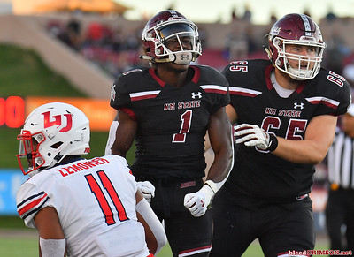 LAS CRUCES, NEW MEXICO - OCTOBER 05, 2019:  Running back Jason Huntley #1 of the New Mexico State Aggies celebrates after rushing for a first down against the Liberty Flames during their game at Aggie Memorial Stadium on October 05, 2019 in Las Cruces, New Mexico.The Flames defeated the Aggies 20-13.  (Photo by Sam Wasson)