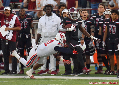 LAS CRUCES, NEW MEXICO - OCTOBER 05, 2019:  Running back Jason Huntley #1 of the New Mexico State Aggies runs for a gain against linebacker Brandon Tillmon #12 of the Liberty Flames during their game at Aggie Memorial Stadium on October 05, 2019 in Las Cruces, New Mexico.  (Photo by Sam Wasson)
