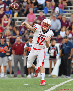 LAS CRUCES, NEW MEXICO - OCTOBER 05, 2019:  Quarterback Stephen Calvert #12 of the Liberty Flames throws a pass against the New Mexico State Aggies during their game at Aggie Memorial Stadium on October 05, 2019 in Las Cruces, New Mexico.  (Photo by Sam Wasson)
