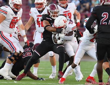 LAS CRUCES, NEW MEXICO - OCTOBER 05, 2019:  Linebacker Javahn Fergurson #7 of the New Mexico State Aggies tackles running back Frankie Hickson #23 of the Liberty Flames during their game at Aggie Memorial Stadium on October 05, 2019 in Las Cruces, New Mexico.  (Photo by Sam Wasson)