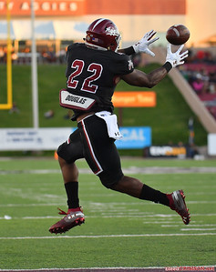 LAS CRUCES, NEW MEXICO - OCTOBER 05, 2019:  Running back Eli Anderson #22 of the New Mexico State Aggies tries to catch a pass against the Liberty Flames during their game at Aggie Memorial Stadium on October 05, 2019 in Las Cruces, New Mexico.The Flames defeated the Aggies 20-13.  (Photo by Sam Wasson)