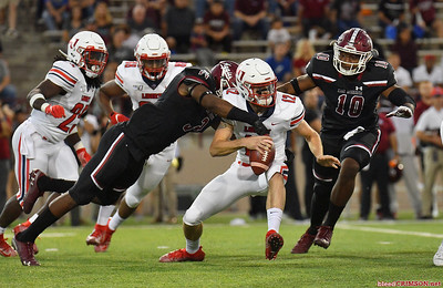 LAS CRUCES, NEW MEXICO - OCTOBER 05, 2019:  Linebacker Devin Richardson #3 of the New Mexico State Aggies tackles quarterback Stephen Calvert #12 of the Liberty Flames during their game at Aggie Memorial Stadium on October 05, 2019 in Las Cruces, New Mexico.  (Photo by Sam Wasson)