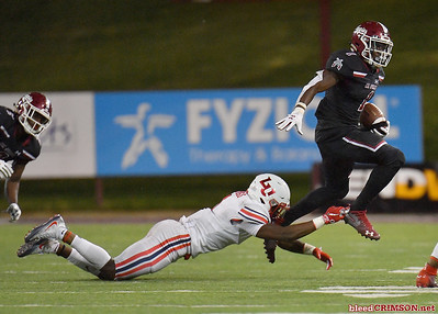 LAS CRUCES, NEW MEXICO - OCTOBER 05, 2019:  Running back Jason Huntley #1 of the New Mexico State Aggies runs for a gain against cornerback Javon Scruggs #1 of the Liberty Flames during their game at Aggie Memorial Stadium on October 05, 2019 in Las Cruces, New Mexico.  (Photo by Sam Wasson)