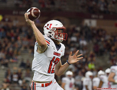 LAS CRUCES, NEW MEXICO - OCTOBER 05, 2019:  Quarterback Stephen Calvert #12 of the Liberty Flames passes against the New Mexico State Aggies during their game at Aggie Memorial Stadium on October 05, 2019 in Las Cruces, New Mexico.  (Photo by Sam Wasson)