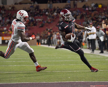 LAS CRUCES, NEW MEXICO - OCTOBER 05, 2019:  Running back Jason Huntley #1 of the New Mexico State Aggies runs for a touchdown against safety Elijah Benton #31 of the Liberty Flames of the Liberty Flames during their game at Aggie Memorial Stadium on October 05, 2019 in Las Cruces, New Mexico.  (Photo by Sam Wasson)