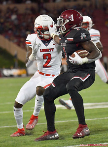 LAS CRUCES, NEW MEXICO - OCTOBER 05, 2019:  Running back Jason Huntley #1 of the New Mexico State Aggies stiff arms cornerback Emanuel Dabney #2 of the Liberty Flames during their game at Aggie Memorial Stadium on October 05, 2019 in Las Cruces, New Mexico.  (Photo by Sam Wasson)
