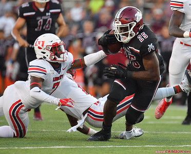 LAS CRUCES, NEW MEXICO - OCTOBER 05, 2019:  Running back Christian Gibson #25 of the New Mexico State Aggies runs for a gain against cornerback Tayvion Land #7 of the Liberty Flames during their game at Aggie Memorial Stadium on October 05, 2019 in Las Cruces, New Mexico.  (Photo by Sam Wasson)