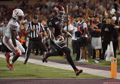 LAS CRUCES, NEW MEXICO - OCTOBER 05, 2019:  Running back Jason Huntley #1 of the New Mexico State Aggies runs for a touchdown against safety Elijah Benton #31 of the Liberty Flames during their game at Aggie Memorial Stadium on October 05, 2019 in Las Cruces, New Mexico.The Flames defeated the Aggies 20-13.  (Photo by Sam Wasson)