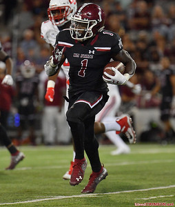 LAS CRUCES, NEW MEXICO - OCTOBER 05, 2019:  Running back Jason Huntley #1 of the New Mexico State Aggies runs for a gain against the Liberty Flames during their game at Aggie Memorial Stadium on October 05, 2019 in Las Cruces, New Mexico.The Flames defeated the Aggies 20-13.  (Photo by Sam Wasson)
