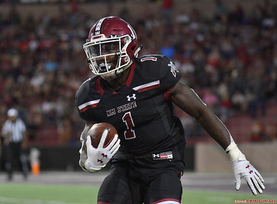 LAS CRUCES, NEW MEXICO - OCTOBER 05, 2019:  Running back Jason Huntley #1 of the New Mexico State Aggies runs after catching a pass against the Liberty Flames during their game at Aggie Memorial Stadium on October 05, 2019 in Las Cruces, New Mexico.  (Photo by Sam Wasson)