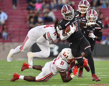 LAS CRUCES, NEW MEXICO - OCTOBER 05, 2019:  Running back Jason Huntley #1 of the New Mexico State Aggies breaks through a tackle from safety Elijah Benton #31 of the Liberty Flames during their game at Aggie Memorial Stadium on October 05, 2019 in Las Cruces, New Mexico.  (Photo by Sam Wasson)