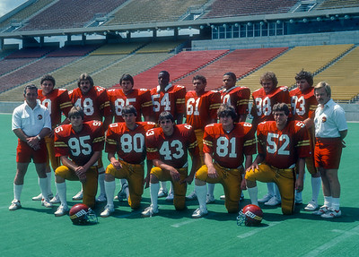 Linebackers with Coaches Larry Coyer and Chuck Lester pose at Iowa State Cyclones football media day in 1981. Back = Ron Troyan, Joel Jenson, George Jessen, Chris Washington, Doug Fischer, Dwayne Gilyard, unknown, Mark Carlson. Front row = Todd Hedgespeth, Jim Luebbers, Tim Iverson, unknown, Doug Van Sloten.  Photo © Wesley Winterink.