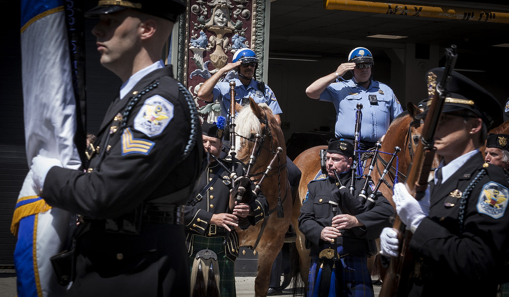 . The annual gathering to remember those who have served in law enforcement and public safety agencies known as the Blue Mass was held in May. The event -- which calls for continued protection for these men and women includes a processional led by bagpipers and observed by mounted police.