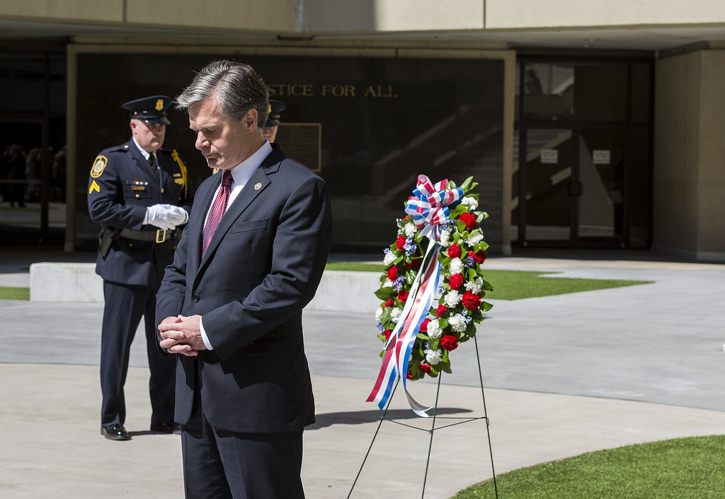 . FBI Director Christopher Wray during the special agent memorial service, held in the courtyard of FBI Headquarters on May 9, 2018. The annual ceremony includes a wreath-laying and honors the memories of special agents who have made the ultimate sacrifice.