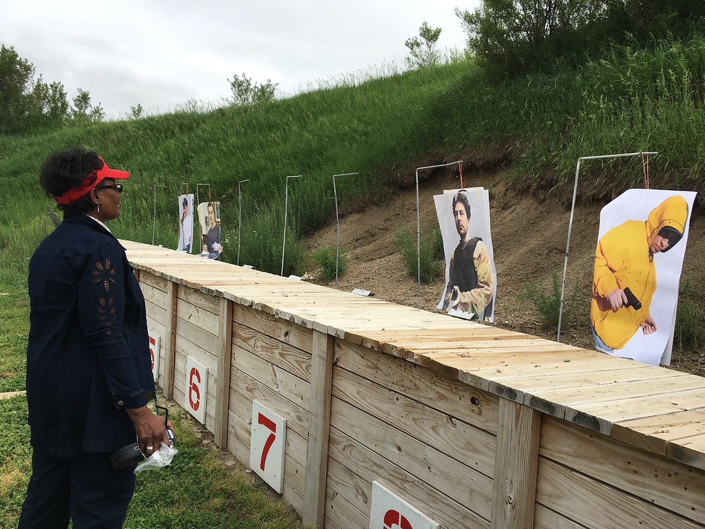 . A member of FBI Detroit Citizens Academy looks at the targets.