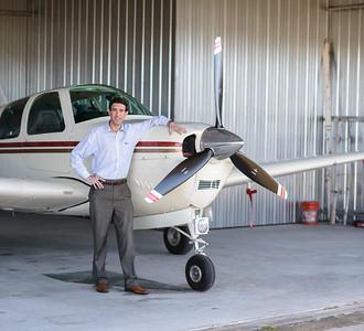 Troy Kinsey with his 1960 Beechcraft Debonair at his hangar at the Quincy Municipal Airport