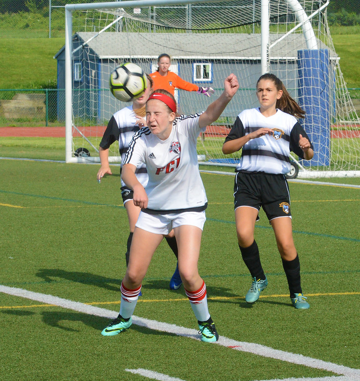 . Caitlin Somerville heads ball in front of goal.