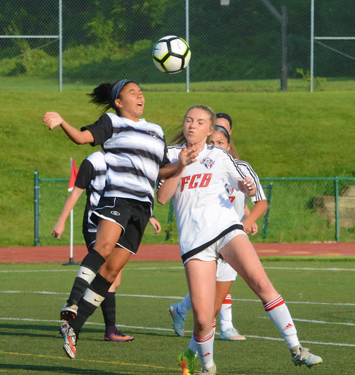 . Jessica Joslyn battles for  headball.