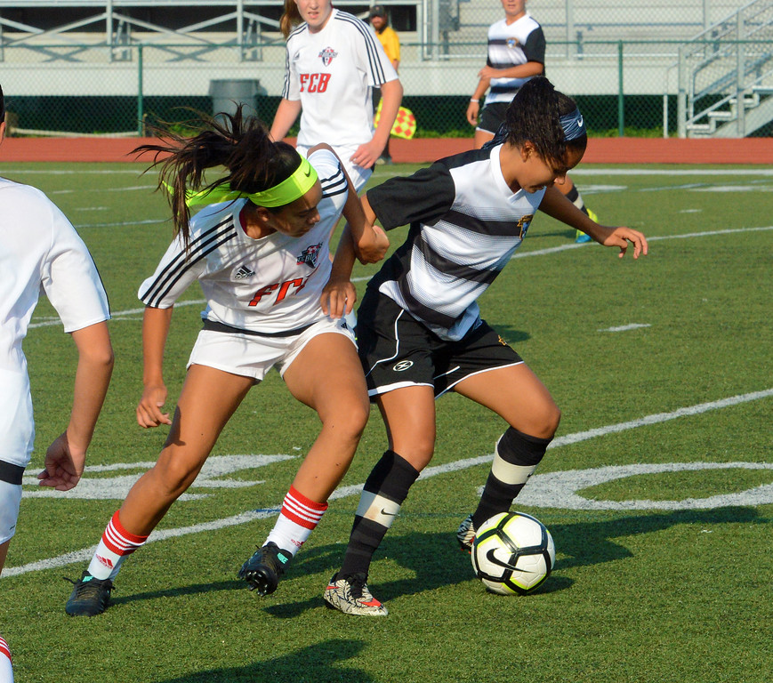 . Abigail Bautista and Fairmont foe engage in soccer battle.