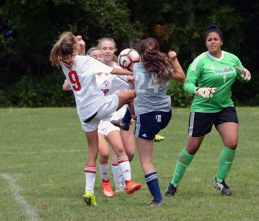 . Jordan O\'Neill, Carly Gross and Jessica Joslyn battle in front of Next Level goal.