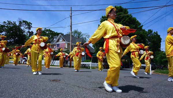 This was taken at the annual Falls Church, Virginia, Memorial Day Parade in 2014. These are Falun Gong practitioners. I was drawn to their bright yellow outfits. It was nearly impossible to take a bad photograph of them.