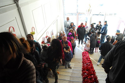 People line up to enter Old Masonic Hall for program that serves families that have been affected by incarceration.