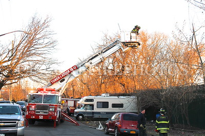 FDNY Tower Ladder 50 operating at a All Hands fire at Da Bronx Box 4456 at 4250 Boston Road for a fire in a recycling yard on April 3, 2013. More Photos in Da Bronx gallery