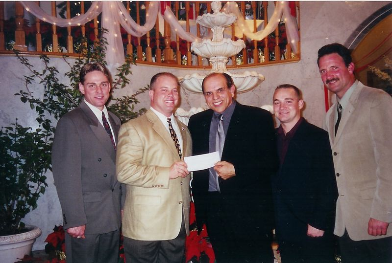 Christmas 2001, Ralph Maccarino, president of Alpa Display, and family of Tom Narducci, makes a  $21,000 donation to the Bravest in memory of those lost on 9/11