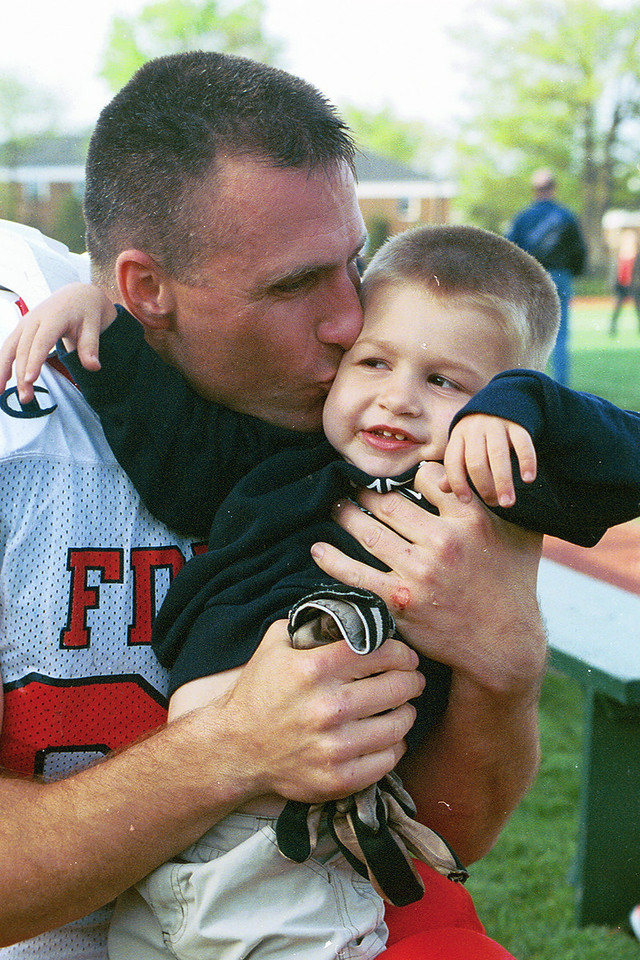John Gormley gives a hug and kiss to little Tommy Cullen who lost his Dad on 9/11
