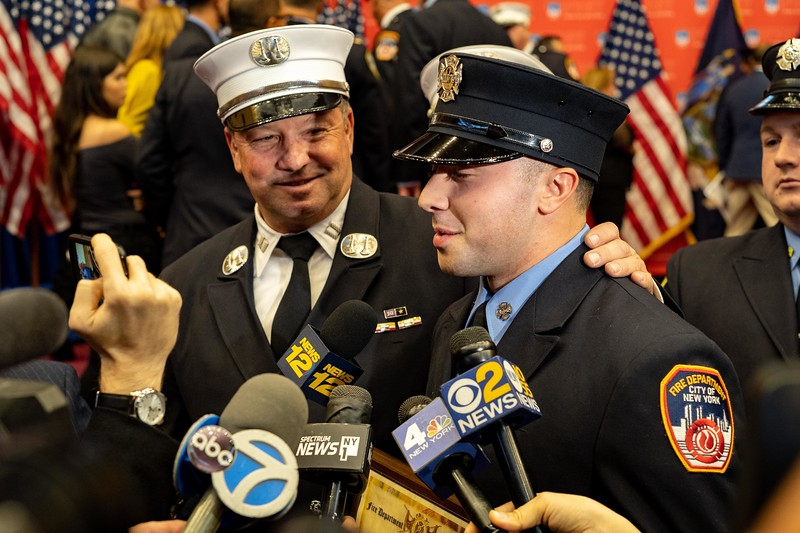 Captain James Spencer with his son, Probationary Firefighter James Spencer Jr. Spencer Jr. is the fourth generation in his family to be a New York City Firefighter.