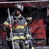 Firefighter Nathanael Igbowu of Ladder Company 131 pulled one of the two people trapped in the Friday morning blaze at the corner of Court and Garnet streets.