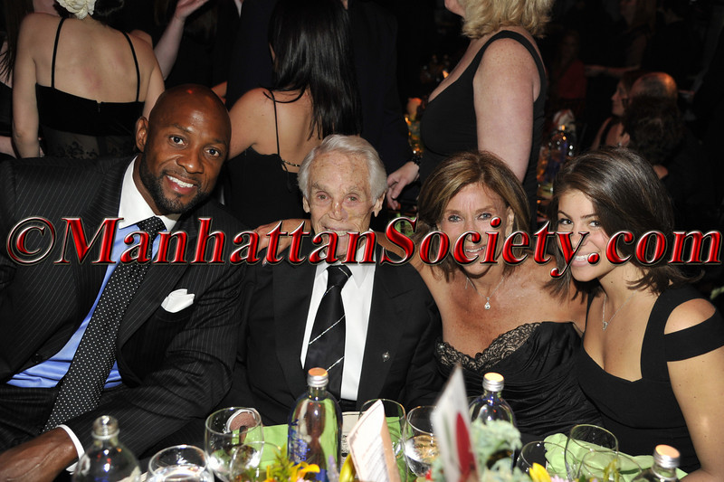"Alonzo Mourning, Tibor Hollo, Sheila Hollo, ? HEALTHCORPS' Fifth Annual Gala ""Fresh From The Garden"" on Wednesday, April 13, 2011 at Intrepid Sea, Air & Space Museum, Pier 86 at 46th Street & 12th Avenue, New York, NY  PHOTO CREDIT: Copyright ©Manhattan Society.com 2011"