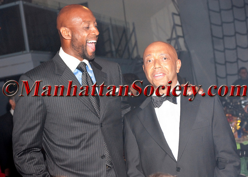 """Alonzo Mourning, Russell Simmons attend HEALTHCORPS' Fifth Annual Gala """"Fresh From The Garden"""" on Wednesday, April 13, 2011 at Intrepid Sea, Air & Space Museum, Pier 86 at 46th Street & 12th Avenue, New York, NY  PHOTO CREDIT: Copyright ©Manhattan Society.com 2011"""