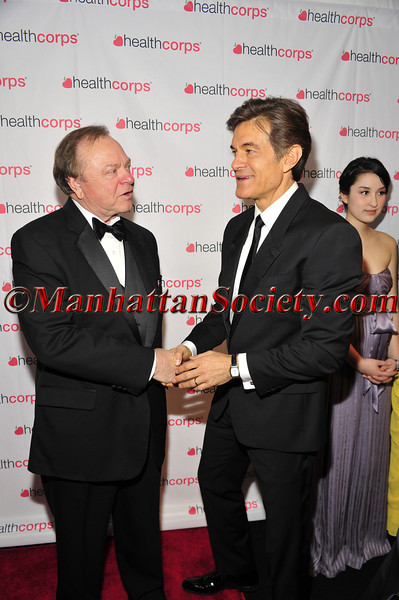 (L-R) Harold Hamm, CEO of Continental Resources and a 2013 HealthCorps Grassroots Garden Honoree and Dr. Oz, Founder of HealthCorps and TV personality stop and greet each other before posing for pictures and the start of the event.