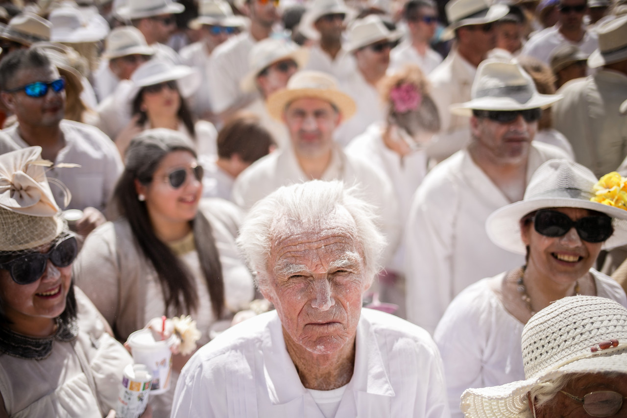 """A reveller known as one of """"Los Indianos"""", covered in talcum powder that was thrown over him, takes part in the carnival of Santa Cruz de La Palma, in the Canary Islands, Spain, Monday February 16, 2015. """"Los Indianos"""" represent the return of emigrants from the Americas, who returned to the island wealthier. (Andres Gutierrez)"""